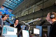 Jan van Doggenaar van SHO (links) en Marco Borsato (midden) zijn te gast in het radioprogramma van Sander de Heer om uitleg te geven over de actie voor Pakistan. In het Nederlands Instituut voor Beeld en Geluid in Hilversum verzamelt een telefoonteam de donaties voor de actie van de Samenwerkende Hulporganisaties (SHO) voor de watersnoodramp in Pakistan. Via een televisieactie worden Nederlanders opgeroepen om geld te geven via Giro 555.<br /> <br /> At the museum for media in Hilversum a call center is taking calls for a donation to the victims of the flooding in Pakistan. The cooperation of aid reliefs is asking people in The Netherlands to donate. Famous Dutchmen are supporting the fund raising. Amongst them is Dutch singer Marco Borsato (middle), who opened the fund raising.