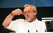 Antony Worrall Thompson cooking ricotta fritters with strawberry sauce. Taste of London 2010 - Chef.