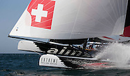 The Extreme Sailing Series 2013. Act 1. <br /> <br /> Showing Alinghi skippered by Ernesto Bertarelli (SUI) with tactician Morgan Larson (USA), mainsail trim Pierre Yves Jorand (SUI), headsail trim Nils Frei (SUI) and bowman Yves Detrey (SUI)<br /> <br /> Muscat. Oman<br /> Please credit: Lloyd Images