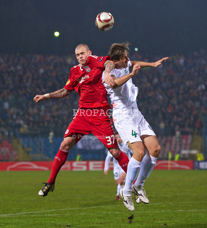 BUCHAREST, ROMANIA - Thursday, February 25, 2010: Liverpool's Martin Skrtel and FC Unirea Urziceni's Ersin Mehmedovic during the UEFA Europa League Round of 32 2nd Leg match at the Steaua Stadium. (Photo by David Rawcliffe/Propaganda)
