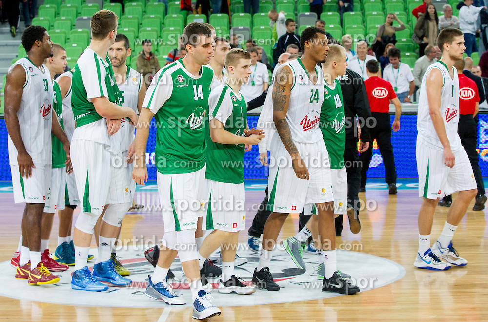 Players of Union Olimpija after the basketball match between KK Union Olimpija Ljubljana and KK Cibona Zagreb in 2nd Round of ABA League 2013/14 on October 10, 2013 in Arena Stozice, Ljubljana, Slovenia. (Photo by Vid Ponikvar / Sportida)