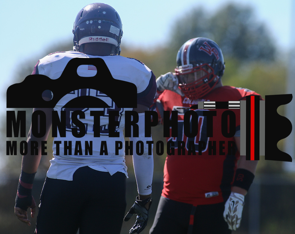Appoquinimink Tight end Christopher Saunders (23) prepares to battle William Penn defensive linemen Timothy Dooley (50) at the line of scrimmage in the second quarter Saturday, Oct. 10, 2015 at Bill Cole Stadium in New Castle, DE.