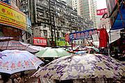Rain lashes the narrow streets of Wuhan.,