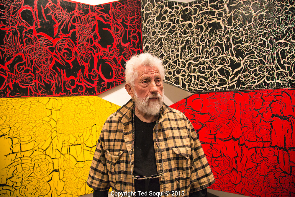 Ed Moses posing in front of his new craquelure artwork.<br /> 89 year old LA artist Ed Moses at his Venice, CA studio.<br /> Ed is having his first solo show in almost 40 years. The show will consist of his drawings from the 1960's and 70's and will be held at the Los Angeles Contemporary Museum of Art.<br /> Ed Moses is considered one of LA's greatest and most successful artist.