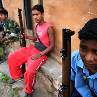 Members of the People?s Liberation Army, the Maoist rebels that control large parts of rural Nepal, take a break in a remote part of western Nepal on June 18, 2006. The ten-year old conflict in Nepal has claimed an estimated 13,000 lives. (Photo/Scott Dalton)
