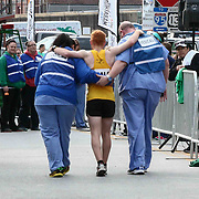 Medical staff assists a runner to the medical tent during 13th Annual Discover Bank Delaware Marathon Sunday, May 8, 2016, at Tubman Garrett Riverfront Park, in Wilmington Delaware.