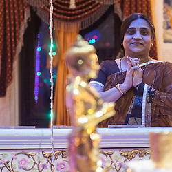 A Hindu woman pays her tributes and pray in front of a statue of Bhagwan Swaminarayan during the celebrations of  Swaminarayan Jayanti at Neasden Temple in London, to mark the manifestation on earth of Bhagwan Swaminarayan in 1781.
