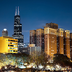 Chicago skyline at night with Sears-Willis Tower building and Grant Park in the foreground.