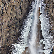 Ice lines the sides of Yosemite Falls on a cold winter morning in Yosemite National Park, California. At 2,425 feet (739 meters), Yosemite Falls is the highest measured waterfall in North America and the fifth-highest in the world.