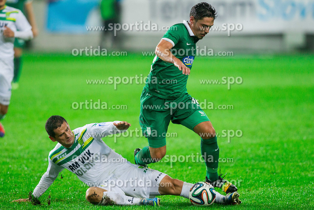 Matija Kristic of Zavrc vs Miran Burgic #30 of Olimpija during football match between NK Olimpija and NK Zavrc in 8th Round of Prva liga Telekom Slovenije 2014/15, on September 13, 2014 in SRC Stozice, Ljubljana, Slovenia. Photo by Vid Ponikvar  / Sportida.com