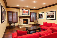 A classy, old world remodel of a newer home. The walls are real venetian plaster. That is a very red couch.