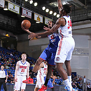 Delaware 87ers Guard Sean Kilpatrick (10) drives towards the basket as Grand Rapids Drive Center Hasheem Thabeet (34) defends in the first half of a NBA D-league regular season basketball game between the Delaware 87ers and the Grand Rapids Drive (Detroit Pistons) Saturday, Apr. 04, 2015 at The Bob Carpenter Sports Convocation Center in Newark, DEL.