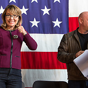 Ret. U.S. Rep. Gabby Giffords (D-Ariz.) (center) and her husband Mark Kelly are introduced as they attend a fundraiser for U.S. Senate candidate Bruce Braley Sunday, Oct. 27, 2013, during the Bruce Blues & BBQ at the Iowa State Fairgrounds in Des Moines, Iowa. (AP Photo/Scott Morgan)