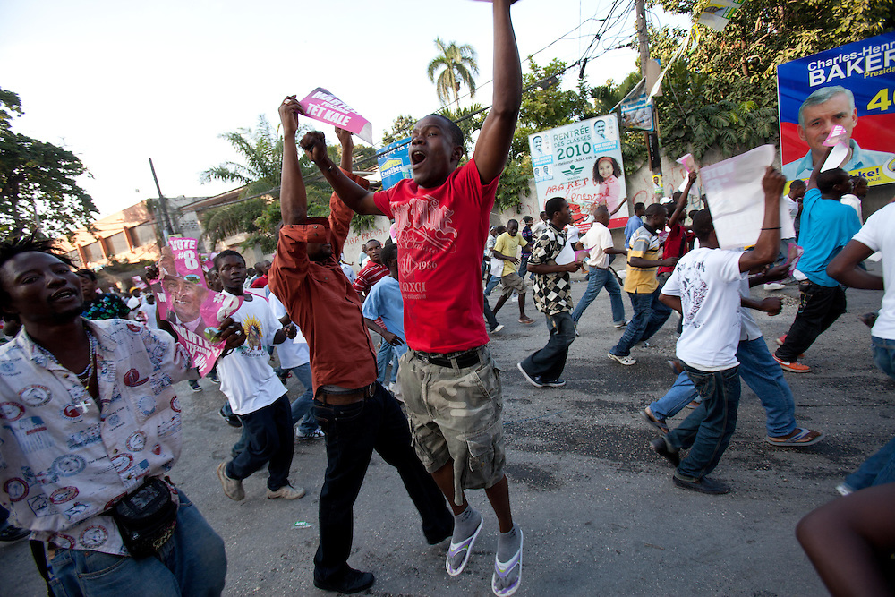 After rumors of election fraud, Michel Martelly supporters take to the streets marching and chanting.