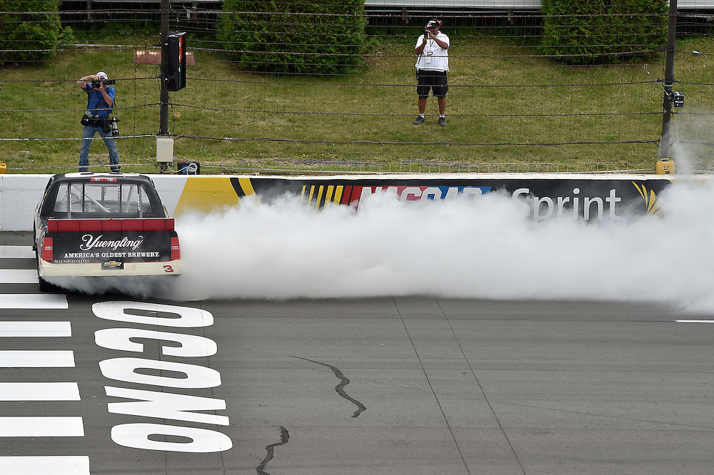 1-2 August, 2014, Long Pond, Pennsylvania USA<br /> Austin Dillon celebrates the win with a burn out<br /> &copy;2014, Scott R LePage <br /> LAT Photo USA
