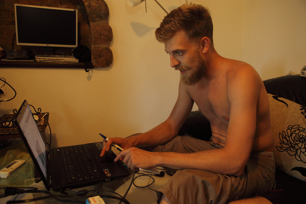 Dutch LSA volunteer Yoshi Livo working on his bitcoins website at the LSA house, Bezdan, Serbia