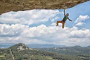 "Chris Sharma climbing ""The Warm Up"" (8a)(13b) at Cova de Ocell near Barcelona Spain"