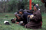 Pilgrims relaxing and praying in the monastery garden. Many pilgrims that come from Tibetan villages spend their nights on the monasteryís yards. .LAMBRANG MONASTERY IN XIAHE - CHINA.copyright: Androniki Christodoulou.