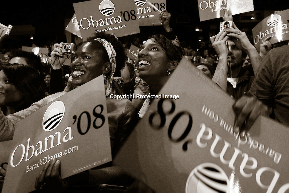 Supporters listen as U.S. Senator Barack Obama (D-IL) gives a speech to students at University of Illinois Chicago February 10, 2007. Obama formally announced his campaign for U.S. presidency during a rally in front if the Old State Capitol in Springfield, Illinois on Saturday..