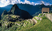 """Machu Picchu is a magnificent Inca archeological site in the Cordillera Vilcabamba, Andes mountains, Peru, South America. Machu Picchu was built around 1450 AD as an estate for the Inca emperor Pachacuti (14381472). Spaniards passed in the river valley below but never discovered Machu Picchu during their conquest of the Incas 1532-1572. The outside world was unaware of the """"Lost City of the Incas"""" until revealed by American historian Hiram Bingham in 1911. Machu Picchu perches at 2430 meters elevation (7970 feet) on a well defended ridge 450 meters (1480 ft) above a loop of the Urubamba/Vilcanota River ( Sacred Valley of the Incas). UNESCO honored the Historic Sanctuary of Machu Picchu on the World Heritage List in 1983. Published in 2009 on Swedish trekking company site www.adventurelovers.se. Published in """"Light Travel: Photography on the Go"""" book by Tom Dempsey 2009, 2010. Panorama stitched from 4 overlapping images."""