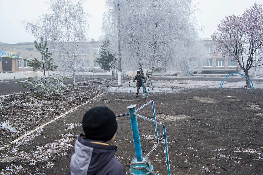 Children play on the school playground on Saturday, December 12, 2015 in Zolote, Ukraine.