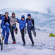Climbers celebrate at Camp Schurman on Mount Rainier in Washington, USA. For licensing options, please inquire.