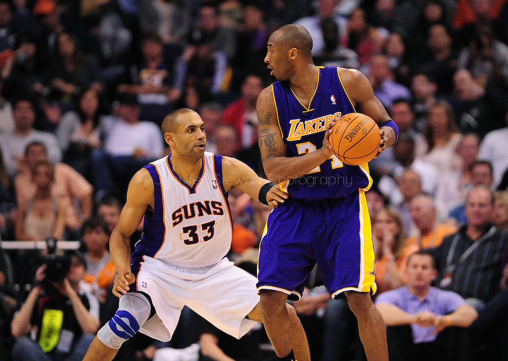 Feb. 19, 2012; Phoenix, AZ, USA;  Los Angeles Lakers guard Kobe Bryant (24) is guarded by the Phoenix Suns forward Grant Hill (33) at the US Airways Center.  Mandatory Credit: Jennifer Stewart-US PRESSWIRE.