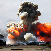An ammunition truck belonging to Qaddafi loyalists erupts in a huge explosion on the main road leading from Benghazi to Ajdabiya. Earlier, NATO forces launched their first air assault on Qaddaffi loyalists advancing on the central city of Benghazi...
