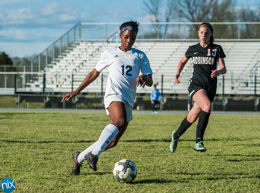 Hickory Ridge's Nia Gaither (12) moves the ball against Jay M. Robinson Friday night at Hickory Ridge High School in Harrisburg. The game ended in a 2-2 draw after double overtime.