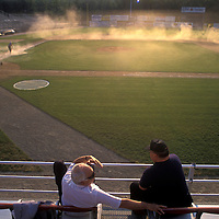 USA, Virginia, Minor league fans sit in stands as groundskeepers work on field before Carolina League baseball game