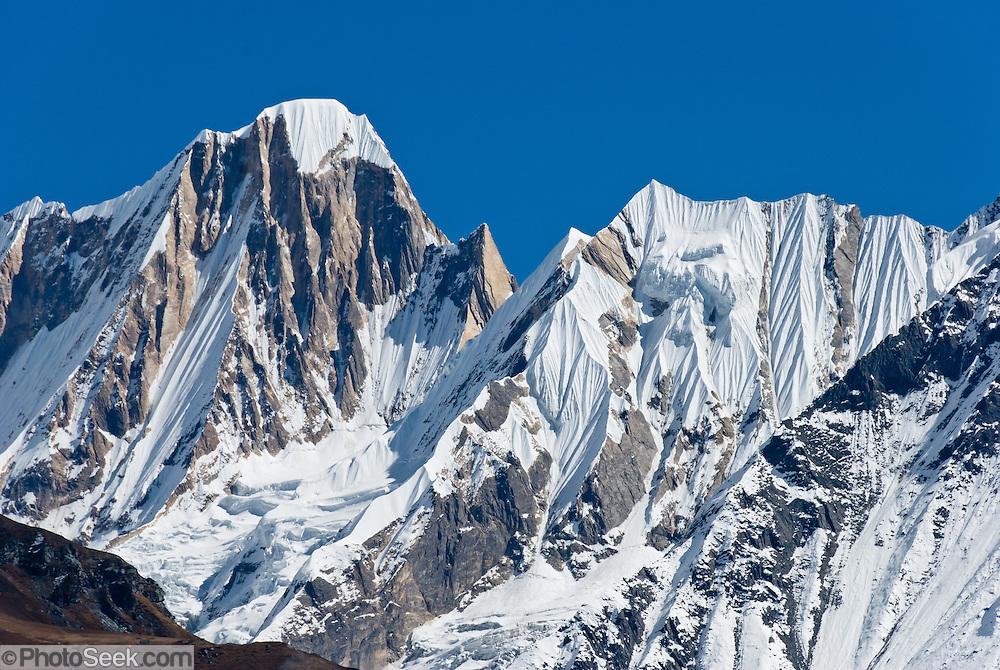 Sharp peaks (part of the ridge between Annapurna III and Gandharba Chuli), with fluted ice ridges, in the Annapurna Range of Nepal, seen from the Annapurna Sanctuary.