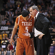 SHOT 2/26/11 5:07:51 PM - Texas head basketball coach Rick Barnes gives some instructions to Cory Joseph (#5) in the closing moments of their game against Colorado during their regular season Big 12 basketball game at the Coors Events Center in Boulder, Co. Colorado upset the fifth ranked Texas 91-89. (Photo by Marc Piscotty / © 2011)