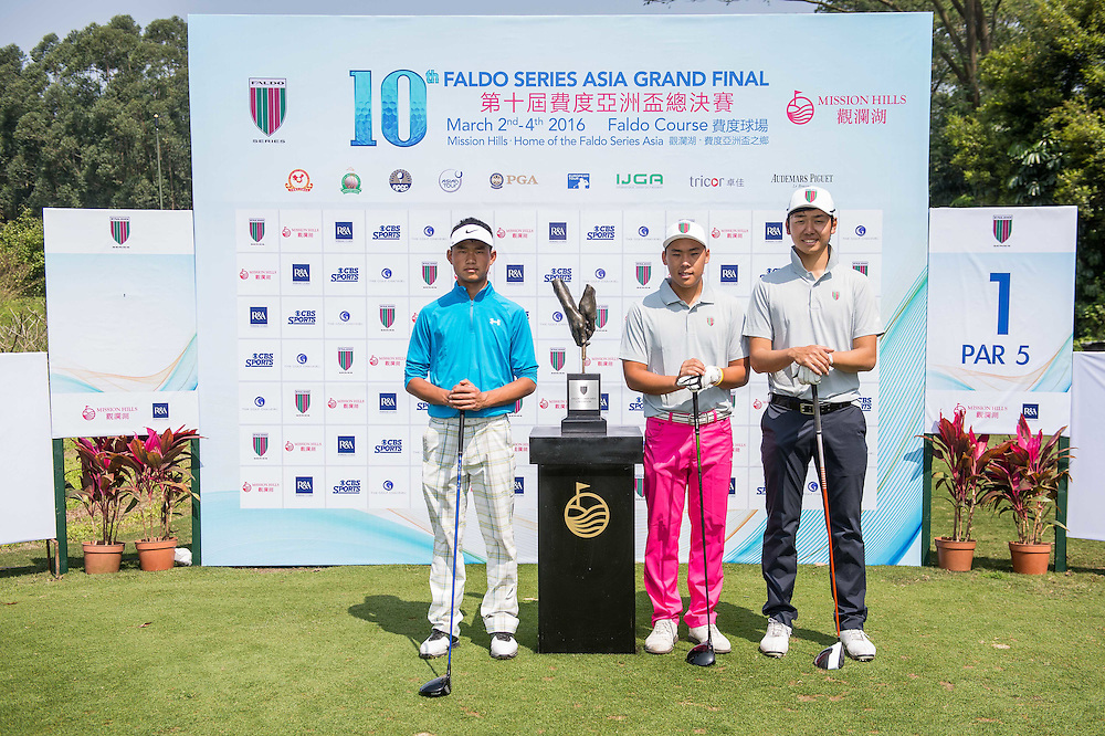 Ibuki Yoshida of Japan, Shouneng Ma of China, Hui Yong Sherng of Malaysia poses for a picture with the trophy during day one of the 10th Faldo Series Asia Grand Final at Faldo course in Shenzhen, China. Photo by Xaume Olleros.