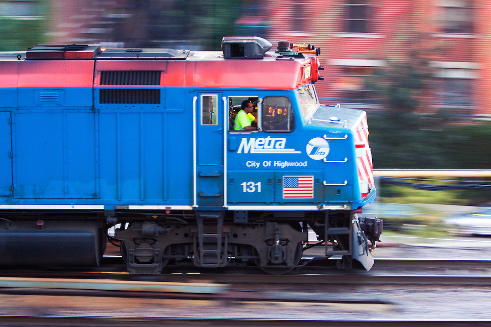 Speeding out of the Ogilvy Transportation Center in Chicago, a Metra locomotive heads for the service pad to get a top off of fuel before leading its rush hour commuter train to the suburbs.