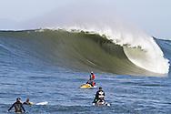Pillar Point Rescue and Mavericks Water Patrol watch an empty giant wave crashing at the Mavericks Surf Contest