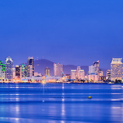 The San Diego skyline is photographed at sunset from Harbor Island. Photography by Dallas commercial photographer William Morton.