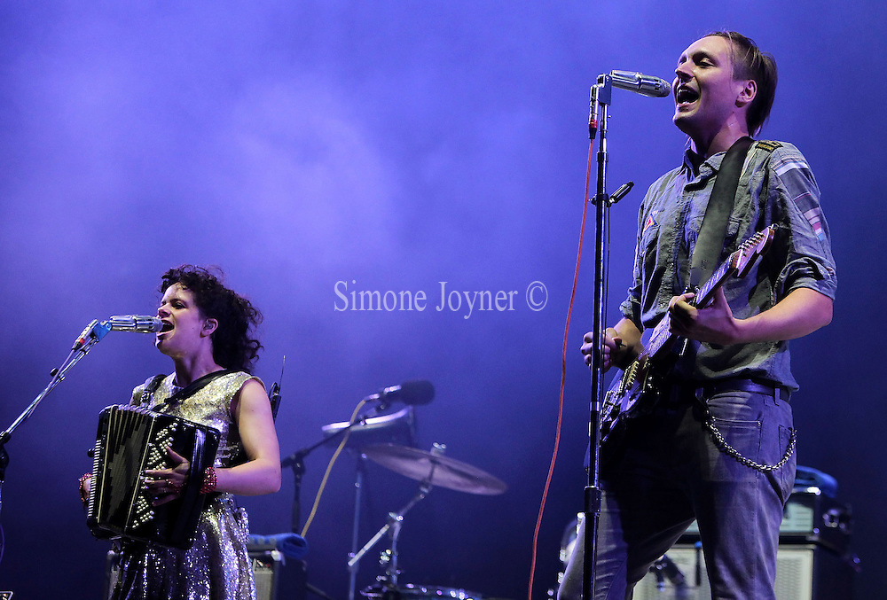 Regine Chassagne and Win Butler of The Arcade Fire performs live on the Main stage during day Two of Reading Festival on August 28, 2010 in Reading, England.  (Photo by Simone Joyner)