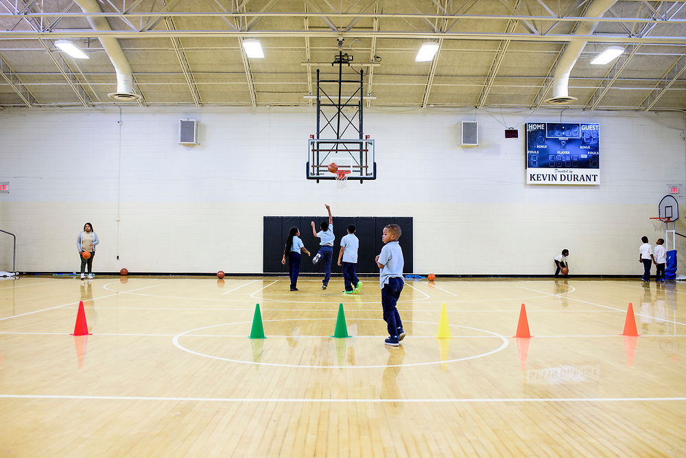Capitol Heights, Maryland - March 29, 2017: Students play at the Seat Pleasant Activity Center's gym March 29, 2017. Both scoreboards in the gym say &quot;Donated by Kevin Durant.&quot;<br /> <br /> NBA super star Kevin Durant has donated a substantial amount of money to help renovate the Seat Pleasant Activity Center where he learned to play basketball. Durant's AAU coach and mentor Charles &quot;Chuckie&quot; Craig, who worked at the Activity Center, was gunned down in May 2005 at the age of 35. Durant wears #35 in Craig's honor.<br /> <br /> <br /> NBA Superstar Kevin Durant's jersey number &quot;35&quot; is a tribute to his rec. league coach and mentor Charles &quot;Chuckie&quot; Craig, who was gunned down in at a night club in Laurel, Md., in 2005 when he was 35 years old. <br /> <br /> CREDIT: Matt Roth for The New York Times<br /> Assignment ID: 30204524A