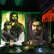 Images of Imam Hussein and his son...In the day of Ashura, and in all the islamic month of Moharram, the Shia Muslims remember the death of the Imam Hussein  killed in the 7th century by the Sunni in the battle of Kerbala (Iraq).