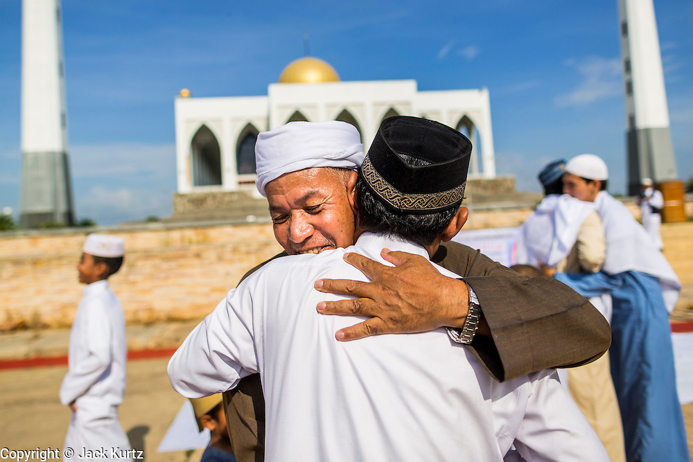 Men greet each other after Eid services at Songkhla Central Mosque in Songkhla province of Thailand. Eid al-Fitr is also called Feast of Breaking the Fast, the Sugar Feast, Bayram (Bajram), the Sweet Festival and the Lesser Eid, is an important Muslim holiday that marks the end of Ramadan, the Islamic holy month of fasting.