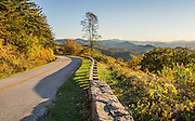 See a lovely sunset view of the Blue Ridge Mountains (a subset of the Appalachian Mountains) at Chimney Rock Mountain Overlook (Milepost 44.9, elevation 2485 feet) on the Blue Ridge Parkway, near Buena Vista, Virginia, USA. Local trees release hydrocarbons into the atmosphere and create a characteristic blue haze. The scenic 469-mile Blue Ridge Parkway connects Shenandoah National Park (in Virginia) with Great Smoky Mountains National Park in North Carolina, following crestlines and the Appalachian Trail.