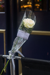 """Compton Street, Soho, London, June 13th 2016. A pair of white roses, a solemn memorial to the 50 people killed at gay club Pulse in Orlando on 12 June, is attached to the balustrade outside The Admiral Duncan, a LGBT-friendly bar that knows too well the price of homophobia, bombed by Neo-Nazi David Copeland on 30 April 1999, killing three people and wounding 70. The message on the card reads, """"Compton Street, Soho, London, June 13th 2016. A pair of white roses, a solemn memorial to the 50 people killed at gay club Pulse in Orlando on 12 June, is attached to the balustrade outside The Admiral Duncan, a LGBT-friendly bar that knows too well the price of homophobia, bombed by Neo-Nazi David Copeland on 30 April 1999, killing three people and wounding 70. The message on the card reads, """"To Orlando, LOVE IS LOVE! Soho stands with you."""" and is signed """"James and Talia""""."""