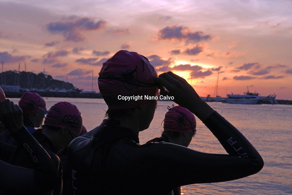 Female triathletes at sunrise, before race start