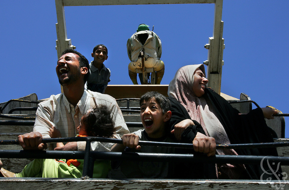 An Iraqi family reacts with a mixture of fear and laughter as they enjoy the swinging ship ride during a leisurely day out at the Sharkh Fun Fair amusement park march 25, 2005 in Baghdad, Iraq.  The modestly priced park provides relief from the daily stresses of living in the often violent Iraqi capital.