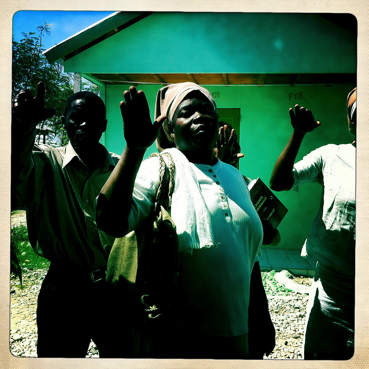 Women pray at the Corail camp on Friday, April 6, 2012 in Port-au-Prince, Haiti.