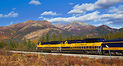 Alaska. Autumn view of the Alaska Railroad heading north after crossing the Parks Highway.