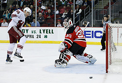 Mar 12, 2009; Newark, NJ, USA; Phoenix Coyotes left wing Joakim Lindstrom (36) tips a puck wide of New Jersey Devils goalie Martin Brodeur (30) during the first period at the Prudential Center.