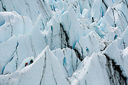 Ice climbers climbing on the terminus of Matanuska Glacier in Southcentral Alaska. Spring. Afternoon.