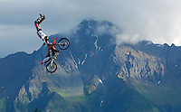 A member of the Xtreme Motorcross Team flies across the vista of Pioneer Peak during a performance at the Alaska State Fair in Palmer.