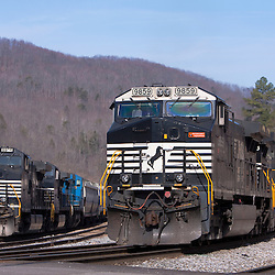 Two Norfolk Southern trains await new crews in small yard in Oakdale, TN.